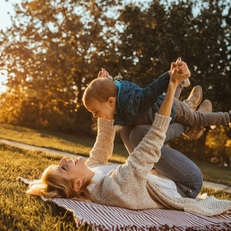 Mom and son have lovely moments together outdoors