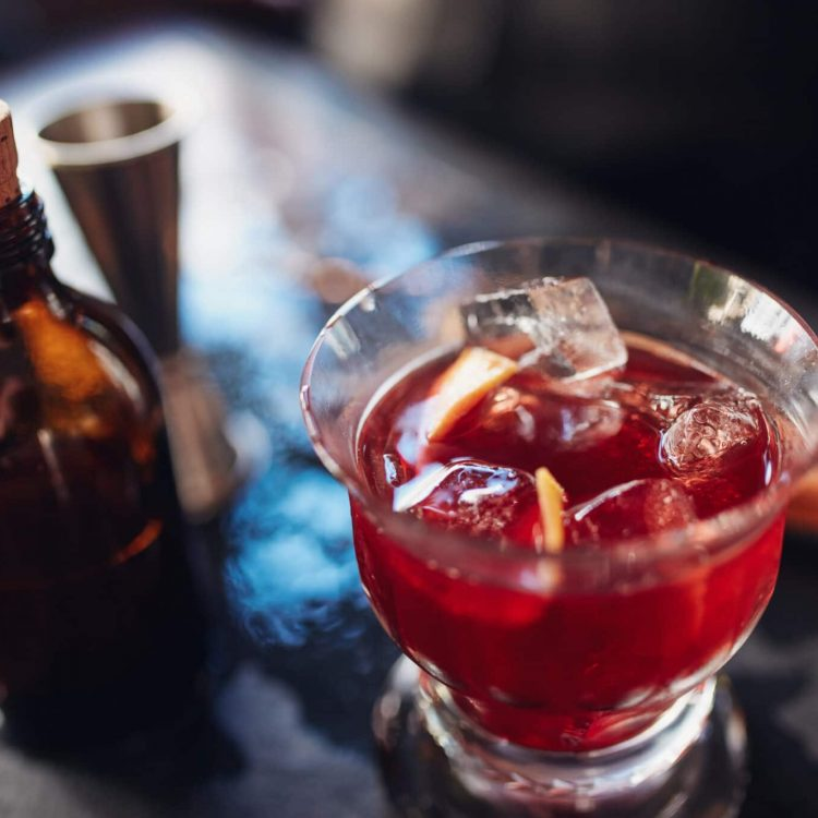 Close up shot of fresh negroni cocktail made from skilled bartenders